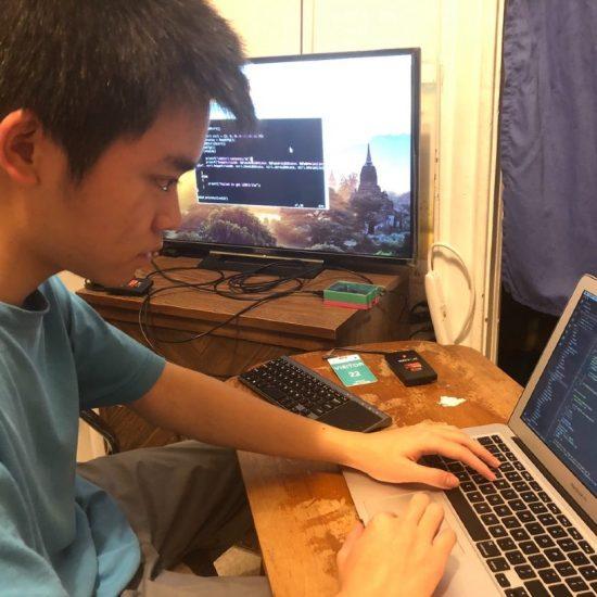 Zhongyi Chen programs an RF reader for UI Health